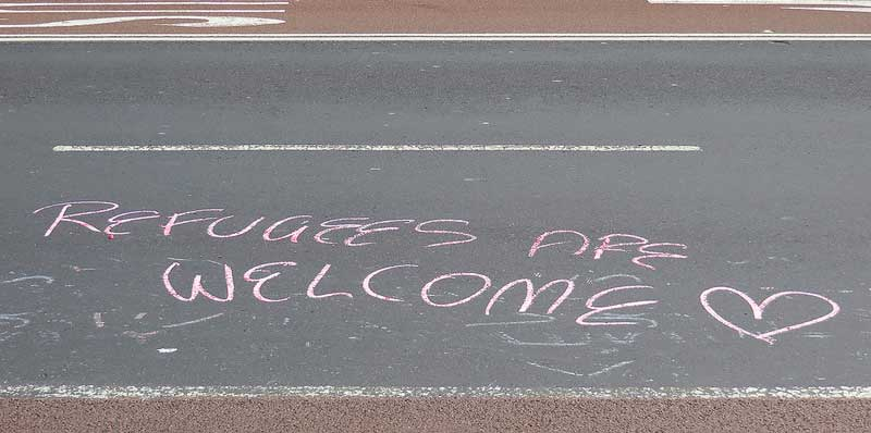 refugess welcome - Newtown grafitti via flickr (CC-BY-2.0)