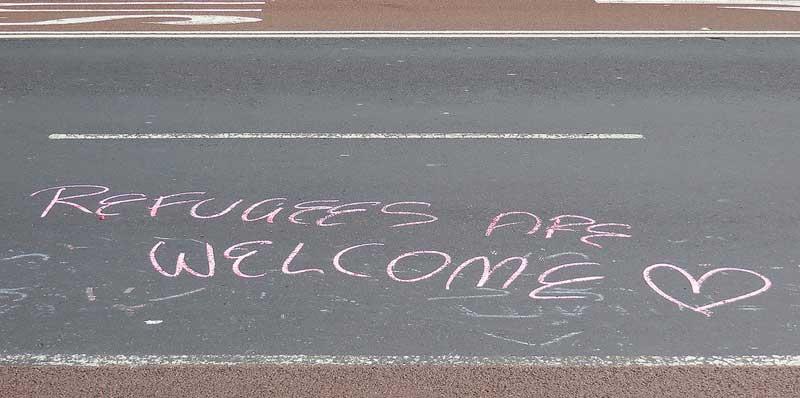 refugess welcome - Newtown grafitti via flickr (CC-BY-2.0)